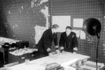 British Royal Navy Commander Cross reviewing a convoy movement map with Captain Lake, Derby House, Liverpool, England, United Kingdom, 26 or 27 Sep 1944