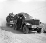 British Diamond T Model 980 tractor towing a trailer loaded with a Churchill tank during preparations for crossing the Rhine River into Germany, 23 Mar 1945
