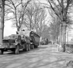Buffalo tracked landing vehicles of UK 4th Royal Tank Regiment being transported forward in preparation for crossing the Rhine River into Germany, 21 Mar 1945