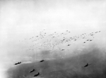 C-47 Skytrain transport aircraft releasing hundreds of paratroopers and their supplies over the Rees-Wesel region in North Rhine-Westphalia, Germany during Operation Varsity, 24 Mar 1945