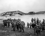 Men of the UK 1st Cheshire Regiment crossing the Rhine River with Buffalo tracked landing vehicles at Wesel, North Rhine-Westphalia, Germany, 24 Mar 1945