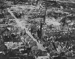 Aerial photograph of a damaged German town during Rhine River area fighting, 24 Mar 1945; taken by crew of B-24 Liberator bomber of 2nd Air Division, US 8th Air Force