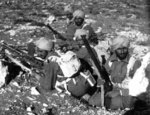 A group of Sikh soldiers of an Indian unit in North Africa during Operation Crusader, late 1941; note Bren machine gun and Lee-Enfield rifles