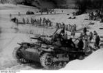 German Panzer III tank and troops in winter camouflage in the Demyansk Pocket, Russia, spring 1943