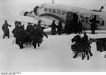 German troops in the Demyansk Pocket unloading supplies from a Ju 52 transport, Russia, Jan 1942