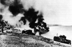 British Churchill tanks and landing craft burning on the Dieppe beach, France, 19 Aug 1942