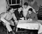 Chinese Major General Zhu Shiming studying a map with Doolittle Raiders Harold Watson, Charles McClure, and Ted Lawson, Walter Reed Hospital, Washington DC, United States, 25 Jul 1942