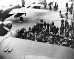 Armorers preparing the Doolittle Raid bombers aboard USS Hornet, 18 Apr 1942, photo 1 of 3