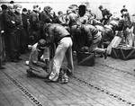 Armorers preparing the Doolittle Raid bombers aboard USS Hornet, 18 Apr 1942, photo 2 of 3
