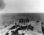 B-25 Mitchell bomber and F4F-4 Wildcat fighters on the flight deck of USS Hornet while en route toward Japan, Apr 1942, photo 2 of 2
