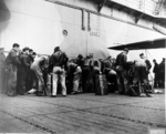 Armorers preparing the Doolittle Raid bombers aboard USS Hornet, 18 Apr 1942, photo 3 of 3