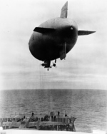 US Navy blimp L-8 delivering 300 pounds of spare parts for B-25 bombers to USS Hornet, off California, United States, 2 Apr 1942