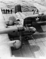 B-25 Mitchell bombers and air crewmen on the flight deck of USS Hornet, Apr 1942, photo 2 of 3