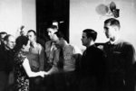 Song Meiling awarding Richard Cole, Henry Potter, Edgar McElroy (shaking hands), Richard Joyce, and Jack Ahren Sims for Doolittle Raid success, Chongqing, China, 29 Jun 1942