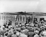 Henry Arnold awarding Doolittle Raiders at Bolling Field, Washington DC, United States, 27 Jun 1942; note B-18 Bolo aircraft in background