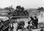 A Flak 18 gun and its crew in Belgium, May 1940; note British Morris C8 tractor and German BMW R18 and DKW NZ350 motorcycles in foreground