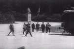Hitler (hand on hip) looking at statue of F. Foch before meeting with French delegation for negotiation of the armistice document, Compiègne, France, 22 Jun 1940; still from 1943 film
