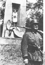German soldier standing next to the memorial of the French victory over Germany in 1918, Compiègne, France, 22 Jun 1940