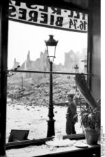 View of ruins of Calais, France from a broken shop window, 5 Jun 1940