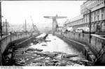 Damaged dock facilities and sunken tug boat at Brest, France, Jun 1940