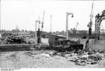 Damaged military universal carrier and civilian vehicles near the docks of Calais, France, May 1940