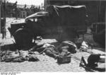 Dead British soldiers in Calais, France, at 1330 hours on 27 May 1940; note Bedford MW truck