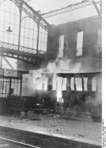 Burning railway car at the rail station in Calais, France, 4 Jun 1940