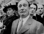 A French civilian weeping as German soldiers marched into Paris, France, 14 Jun 1940