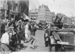 A Dutch woman welcoming German SS troops arriving in Amsterdam, the Netherlands, May 1940