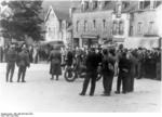 Suspected resistance fighters being rounded up in a city in France, Jul 1944