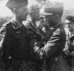 A French Army colonel awarding Operation Jedburgh personnel Jean Larrieu the Croix de Guerre with Palm, Place Bellecour, Lyon, France, 5 Sep 1944