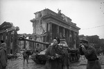 Soviet Army photographer Yevgeny Khaldei in Berlin, Germany, May 1945; note Brandenburg Gate in background