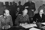 Jodl signing surrender documents at Eisenhower