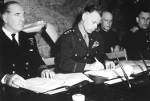 LtGen Bedell Smith signing the documents of Germany's surrender, Reims, France, 7 May 1945. British Adm Harold Burrough is on the left. Soviet Gen Ivan Susloparov is on the extreme right.