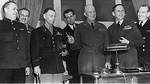 Generals Susloparov, Morgan, Smith, Eisenhower, Air Chief Marshal Tedder after signing of German surrender documents, Rheims, France, 7 May 1945, photo 1 of 3; note Eisenhower holding pens used