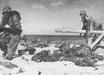 American Marines negotiating Japanese-laid barb wire, Betio, Tarawa Atoll, 21 Nov 1943