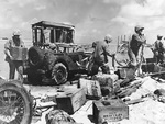 US Marines unloading ammunition from a jeep which had just been driven directly off of a landing barge, Tarawa, Gilbert Islands, Nov 1943
