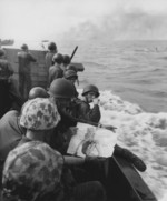 US Marines with a pin-up girl picture in a landing craft, off Tarawa, Nov 1943