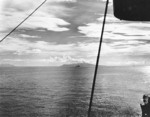 Destroyer sailed between Guadalcanal and Tulagi, Savo Island in distance, circa late 1942