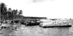 United States Coast Guard landing craft and barges delivering supplies to Guadalcanal, Solomon Islands, late 1942