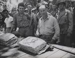 USMC Lieutenant Colonel W. W. Stickney preparing to cut a Thanksgiving holiday cake with a captured Japanese sword, Guadalcanal, Solomon Islands, circa 26 Nov 1942