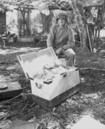 US Marine Colonel Frank Goettge with captured Japanese currency, Guadalcanal, Solomon Islands, Aug 1942