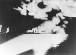Quincy illuminated by Japanese searchlights during Battle of Savo Island, 9 Aug 1942