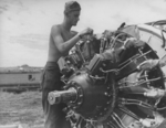 US Marine aircraft mechanic at work, Henderson Field, Guadalcanal, Solomon Islands, Nov 1942