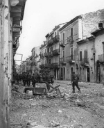 Troops of Canadian Loyal Edmonton Regiment and tank of Canadian Three Rivers Regiment, Ortona, Italy, 20-28 Dec 1943
