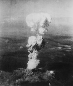 Mushroom cloud rising over Hiroshima, Japan seen from B-29 bomber Necessary Evil, 6 Aug 1945