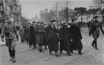 Polish Jews being gathered by German police as forced laborers, Warsaw, Poland, Mar 1940