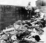 American soldiers inspecting a train car full of dead prisoners at Dachau Concentration Camp, Germany, circa May 1945