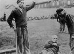 Liberated prisoners killing German guards at Dachau Concentration Camp, Germany, early May 1945