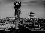 An aircraft spotter atop a London building, St. Paul